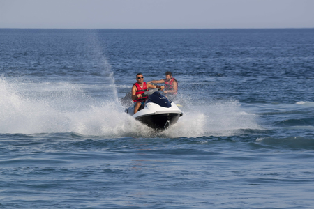 personal watercraft: CAMYUVA, KEMER, TURKEY - JULY 16, 2015: Unidentified Turkish men compete with each other on water scooters. Extreme water sports are increasingly popular on the beaches of Turkey