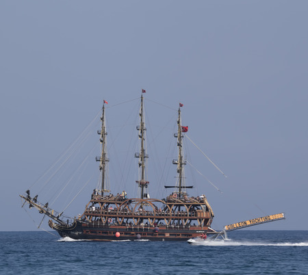 schooner: CAMYUVA, KEMER, TURKEY - JULY 11, 2015: On the coast of Turkey widespread various marine activities. Among them walks on boats and yachts, stylized pirate schooner Editorial