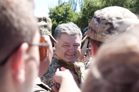 ceremonial: SLOVIANSK, UKRAINE - JULY 5, 2016:  President of Ukraine Petro Poroshenko berween the soldiers of the Armed Forces of Ukraine in Sloviansk  at the ceremonial meeting in honor of the second anniversary of Sloviansk liberation from Russian fighters