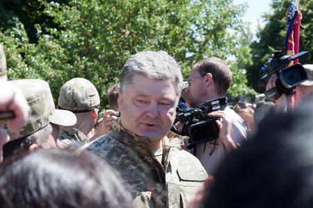 ceremonial clothing: SLOVIANSK, UKRAINE - JULY 5, 2016:  President of Ukraine Petro Poroshenko talks with people in Sloviansk at the ceremonial meeting in honor of the second anniversary of Sloviansk liberation from Russian fighters