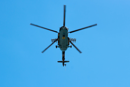 ceremonial clothing: SLOVIANSK, UKRAINE - JULY 5, 2016: Helicopter Armed Forces of Ukraine flew over the area in Sloviansk  at the ceremonial meeting in honor of the second anniversary of Sloviansk liberation from Russian fighters