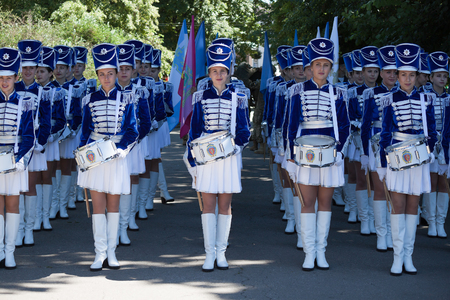 ceremonial clothing: SLOVIANSK, UKRAINE - JULY 5, 2016: Band-drummer girls preparing for the procession in Sloviansk at the ceremonial meeting in honor of the second anniversary of Sloviansk liberation from Russian fighters Editorial