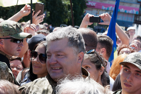 ceremonial: SLOVIANSK, UKRAINE - JULY 5, 2016:  President of Ukraine Petro Poroshenko talks with people in Sloviansk at the ceremonial meeting in honor of the second anniversary of Sloviansk liberation from Russian fighters