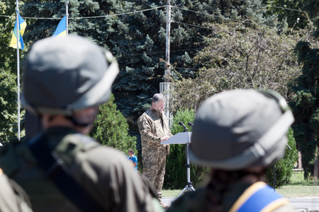 ceremonial: SLOVIANSK, UKRAINE - JULY 5, 2016: President of Ukraine Petro Poroshenko is speaking at the ceremonial meeting in Sloviansk in honor of the second anniversary of Sloviansk liberation from Russian fighters Editorial