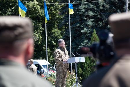 ceremonial clothing: SLOVIANSK, UKRAINE - JULY 5, 2016: President of Ukraine Petro Poroshenko is speaking at the ceremonial meeting in Sloviansk in honor of the second anniversary of Sloviansk liberation from Russian fighters Editorial