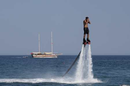 jet skier: CAMYUVA, KEMER, TURKEY - JULY 16, 2015: Unidentified Turkish man hovered above the water. Extreme water sports are increasingly popular on the beaches of Turkey