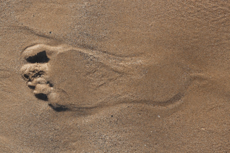 trace: Trace a bare foot on the sand