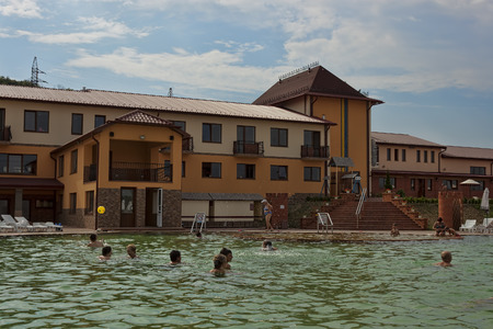 hydromassage: BEREGOVO, UKRAINE - JULY 4, 2015: In the pool with thermal waters in Beregovo. There is always a lot of people at any time of the year