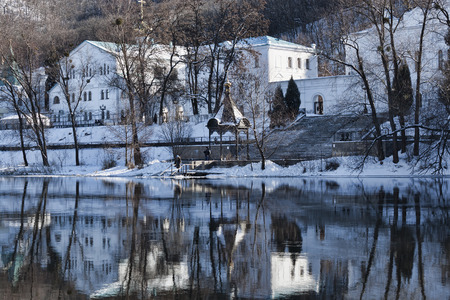 Churches of Sviatohirsk Lavra. Sunny day in January. Gazebo Chapel on the River