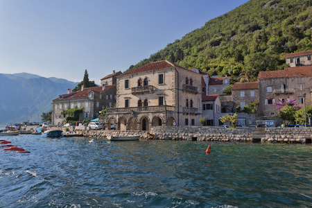PERAST, MONTENEGRO - JUNE 27, 2017: Small towns on the shore of the Kotor Bay attract many tourists