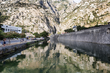 impregnable: KOTOR. MONTENEGRO - JUNE 27, 2017: The river Shkurda is a river running along the fortress wall of Kotors Old Town.