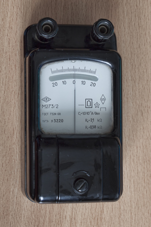 The old device is a micro-galvanometer for measuring microcurrents. Manufacture of the Soviet Union