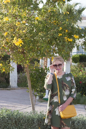 A woman of mature years among the January flowers of Sharm El Sheikh