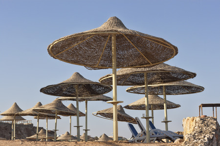 Free sunbeds and umbrellas on the beach against the sky Stock Photo