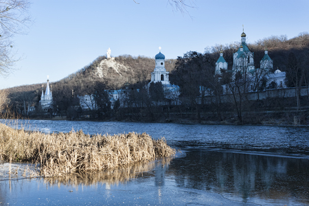 Siversky Donets river and Churches of Lavra in Sviatohirsk, January. Ukraine, Donetsk region Stock Photo