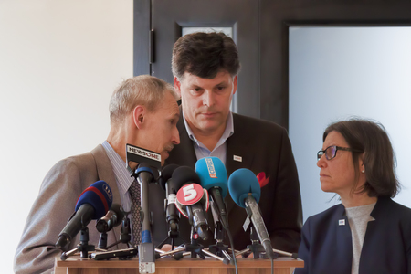 SLOVIANSK, UKRAINE - MAY 15, 2018: Brock Burman (in center), Assistant Administrator of the United States Agency for International Development (USAID) before Kurt Walkers press conference in Sloviansk Editorial