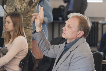 SLOVIANSK, UKRAINE - MAY 15, 2018: Oleg Zontov, a Sloviansk journalist, at a press conference by Kurt Volker, asks for peacekeepers on the Donbass Editorial