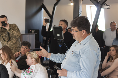 SLOVIANSK, UKRAINE - MAY 15, 2018: A journalist at the Moscow editorial board of Radio Svoboda, at a press conference by Kurt Volcker in Sloviansk, asks questions about talks with Mr. Surkov