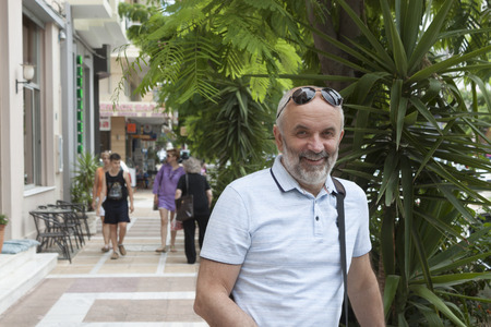 Portrait of a mature man on the street in Loutraki, Greece