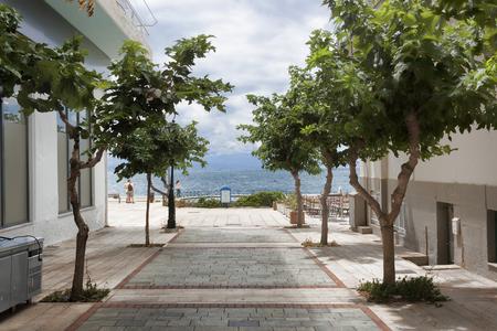 Street leading to the sea. Loutraki, Greece, cloudy summer day Stock Photo