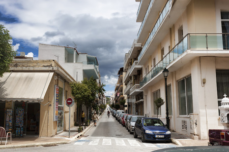 LOUTRAKI, GREECE - JUNE 28, 2018: On the street of Loutraki on a cloudy summer day