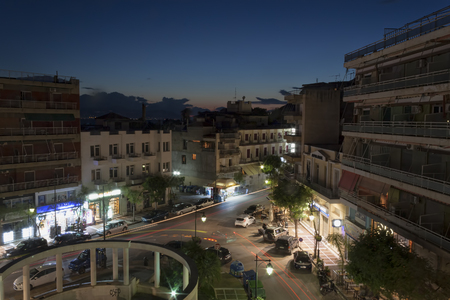 LOUTRAKI, GREECE - JUNE 28, 2018: Square March 25, late at night, top view. Its always noisy here