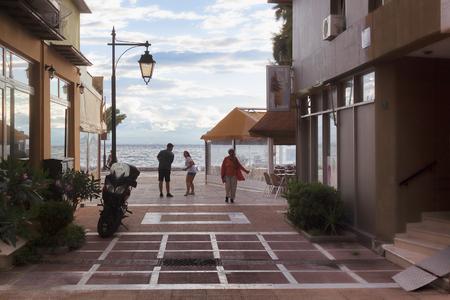 LOUTRAKI, GREECE - JUNE 27, 2018: On the street of Loutraki on a cloudy summer day Editorial