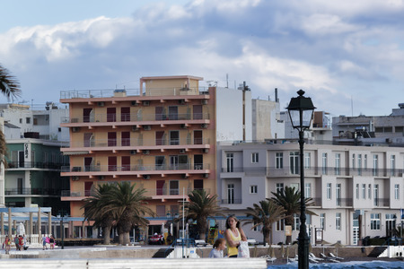 LOUTRAKI, GREECE - JUNE 28, 2018: The embankment of Loutraki on a cloudy summer day. Even in bad weather there are many tourists