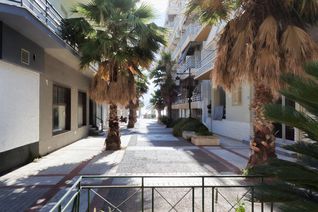 LOUTRAKI, GREECE - JUNE 28, 2018: On the street of Loutraki on a summer day with clouds Editorial