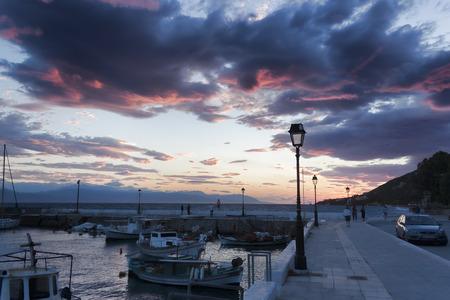 LOUTRAKI, GREECE - JUNE 29, 2018: The embankment of Loutraki on a cloudy summer day. Evening, sunset Editorial