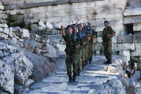ATHENS, GREECE - JUNE 29, 2018: Change of guard in the Athens Acropolis. Among tourists, a very popular sight