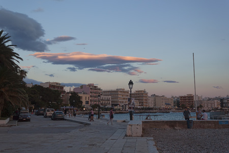 LOUTRAKI, GREECE - JUNE 29, 2018: On the waterfront of Loutraki after sunset Editorial