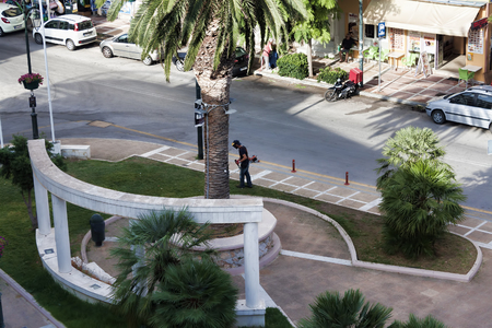 LOUTRAKI, GREECE - JULY 6, 2018: On the Loutraki square of 25 March. Top view