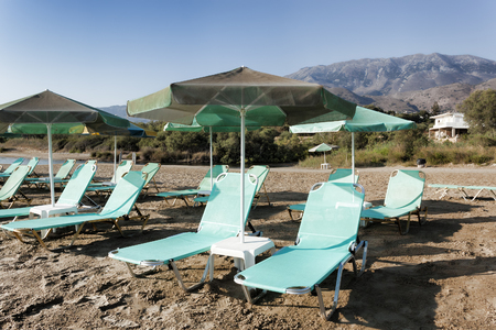 Empty chaise lounges on Georgioupolis beach early in the morning, Crete, Greece