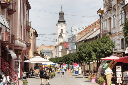 UZHGOROD, UKRAINE - AUGUST 3, 2015: On the streets of the old part of the city in Uzhgorod there are always a lot of people