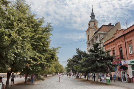 BEREHOVE, UKRAINE - AUGUST 4, 2015: On the central street of Berehove there are always many tourists and locals