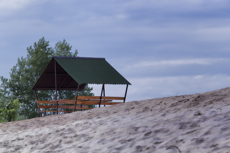 Gazebo without people on the sandy beach