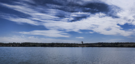 Dramatic sky over the blue lake. Panoramic view Stock Photo