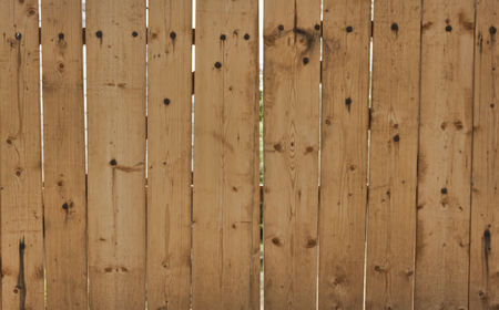 Wooden gates made of freshly planed boards. Background
