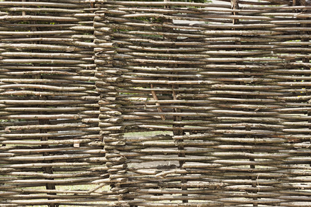 A fence of twigs rods. Authentic Ukrainian wattle fence Stock Photo