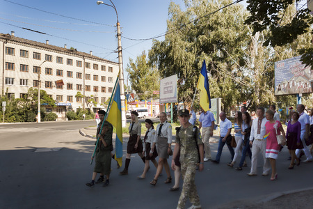 SLOVIANSK, UKRAINE - AUGUST 23, 2015: On the streets of Slavyansk people march in honor of the national flag holiday