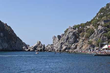 The rocky shore of Simeiz, despite this narrow beaches in summer filled with holidaymakers