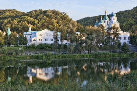 Sviatohirsk Lavra on the shore of the Seversky Donets. Reflections in water. Middle september
