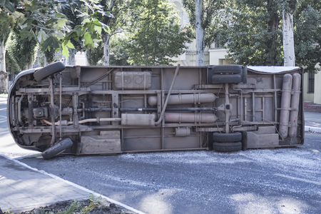 The bottom of the minibus that rolled over on its side, due to an accident Stock Photo
