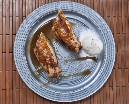 Apple strudel with jam and ice cream