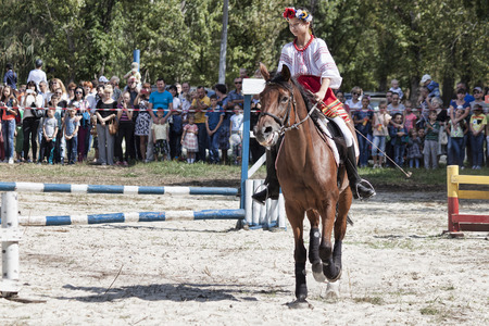 SLOVIANSK, UKRAINE - SEPTEMBER 11, 2016: Unidentified girl in a national costume on a horse at the opening of the regional equestrian championship