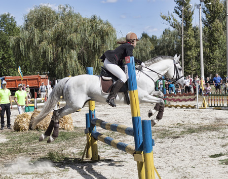 SLOVIANSK, UKRAINE - SEPTEMBER 11, 2016: Unidentified rider overcomes the obstacle. Jumping. Championship of Donetsk region
