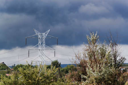 Power line support against the backdrop of a dramatic autumn sky