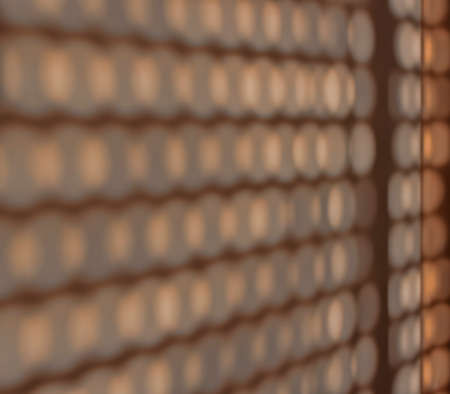 Abstract background. Shadows on the wall from the holes in the blinds