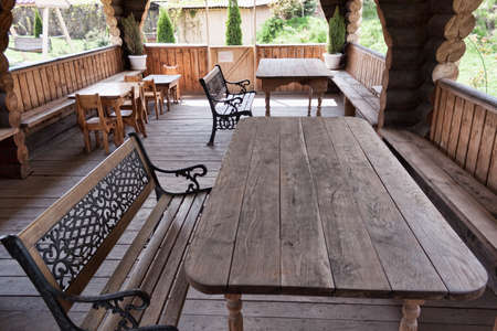 Interior. In a wooden building several wooden tables and benches